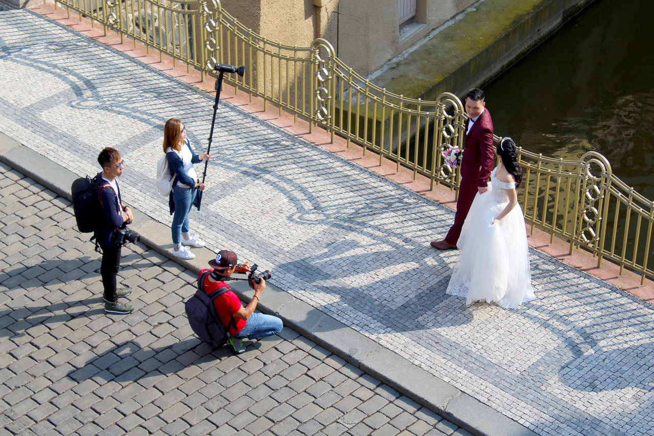 Sydney wedding photographer and his team taking prenup photos with the couple.